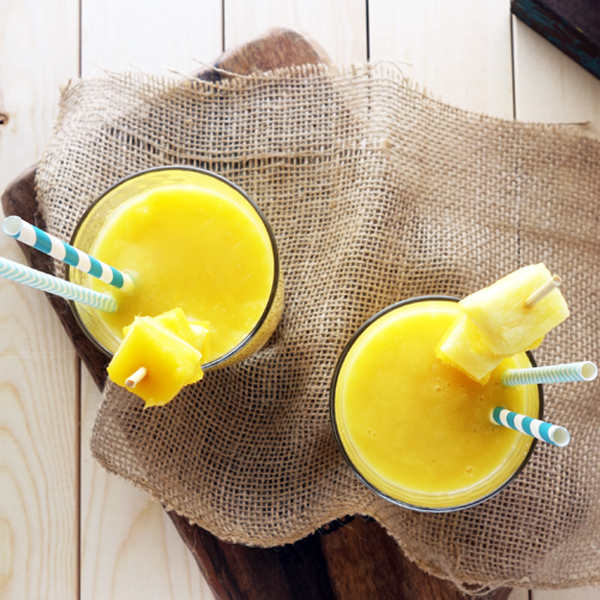 Pineapple Mango Smoothie. Easy to whip up. Delicious. Healthy. Did I mention delicious? So good. Perfect combo of sweet and tangy.