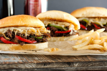 Bulgogi Philly Cheesesteak Sandwich - tender & juicy ribeye korean bulgogi style with caramelized onions, seared peppers & melted cheese.