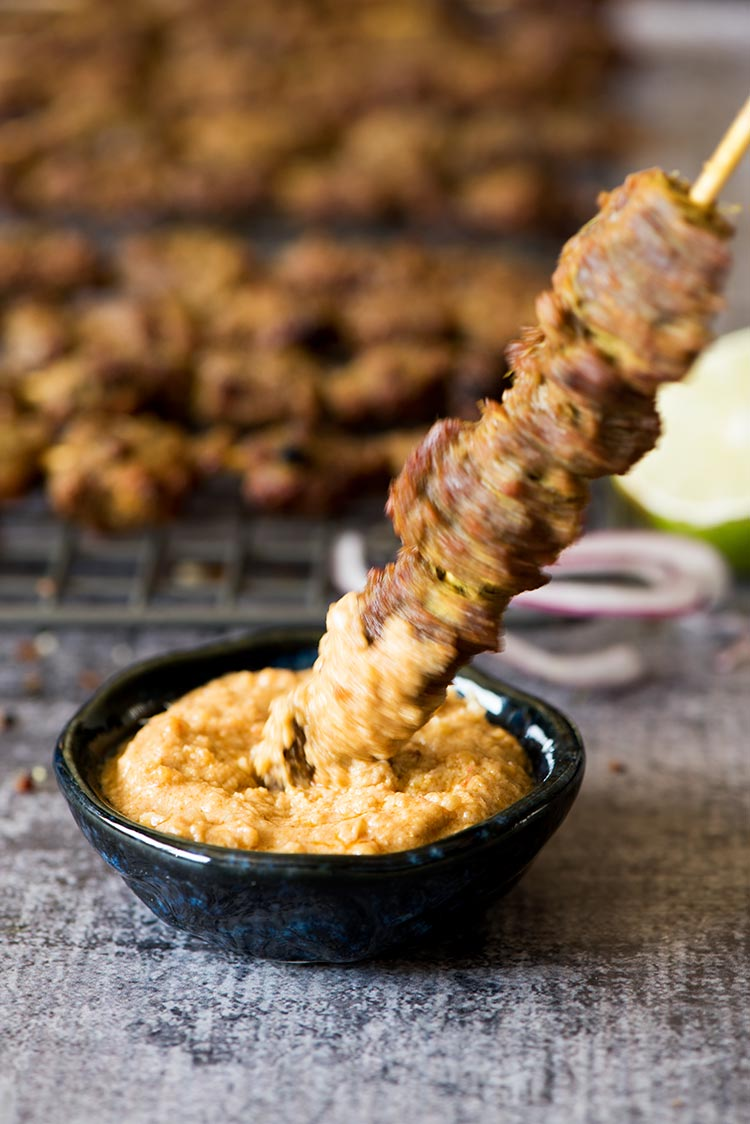 Flavorful, tender smoky beef satay marinated with plenty of herbs and spices dipped in a delectable savory, spicy, sweet peanut sauce.