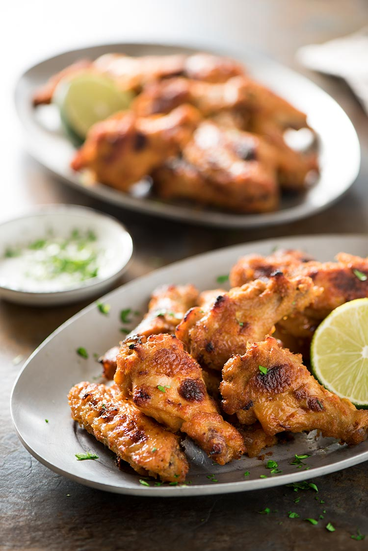 Spicy Lemongrass Wings - Perfectly spicy, savory, sweet & filled with Southeast Asian flavors. Marinated in a flavor packed paste marinade, they are so addictive.