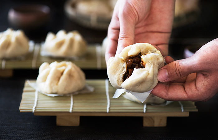 Freshly steamed spongy and slightly chewy bun with a warm, juicy, flavorful bbq pork filling inside. Super simple to make at home.