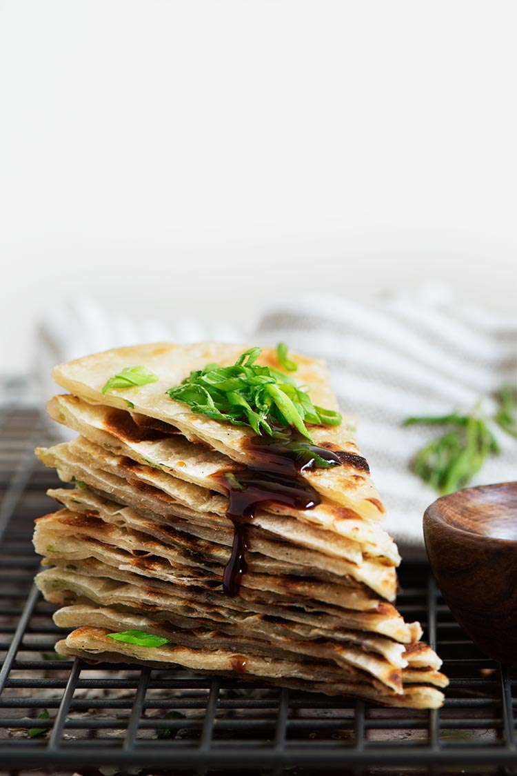 Extra crispy & flaky, lightly chewy Taiwanese Scallion Pancake. Savory pancakes fried to perfection with just 5 ingredients to make at home.