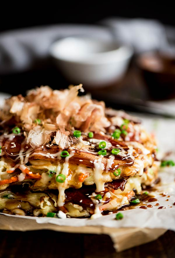 Delightful savory Japanese pancakes made from an easy to make batter, cabbage and bacon topped with Japanese mayo and okonomiyaki sauce.