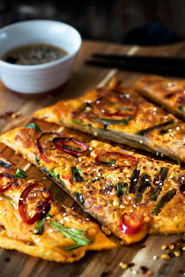 Savory Kimchi Pancake - The perfect appetizer or snack. Crispy outside, light & fluffy inside with delicious kimchi in each bite. Find out the trick to making it crisp, light & fluffy.