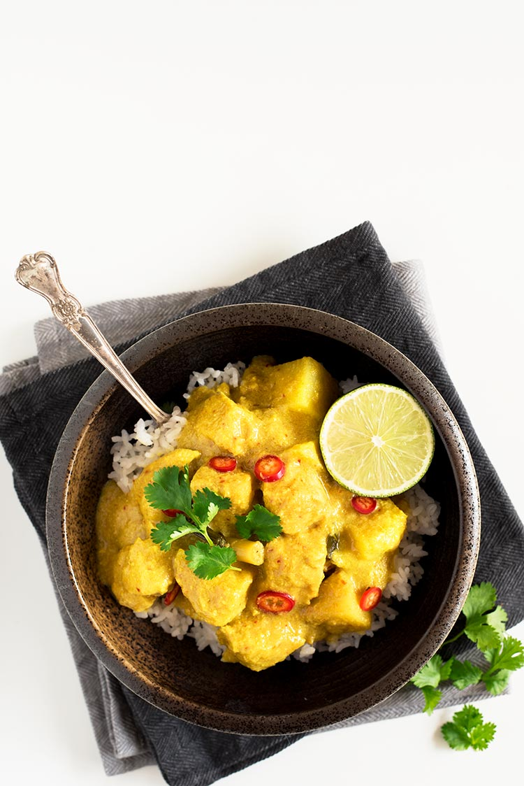 Savory and slightly tangy creamy curry with the softest & juiciest chicken ever and delicious tender potatoes.