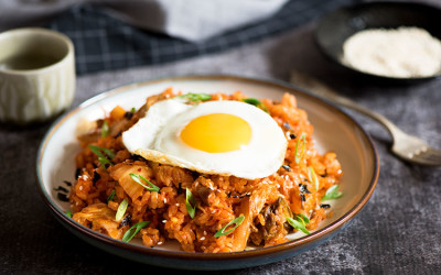 Spicy kimchi pork belly fried rice with sunny side eggs cooked in under 10 minutes.